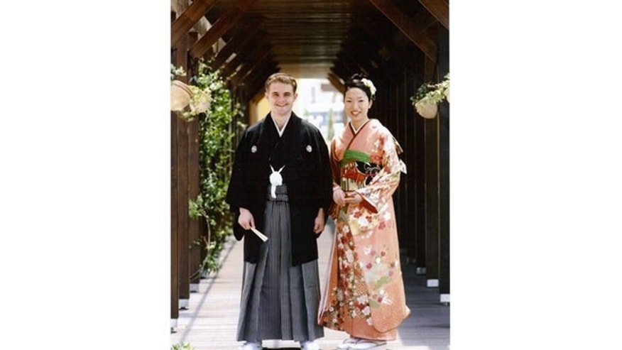 July 26: Iraq War veteran Joey and Miwa Neal on their wedding day outside the Ushitora Shrine in Fukuyama, Japan.