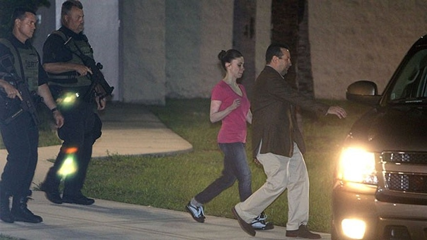 July 17: Casey Anthony, center, walks to a SUV with her lawyer Jose Baez after her release from the Orange County Jail in Orlando, Fla.