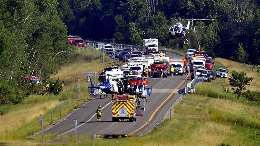 July 17: The area where state police say a tour bus crashed on Interstate 390 in Steuben County, about 55 miles southeast of Rochester, is seen in Cohocton, N.Y. Authorities say the crash caused numerous injuries and shut down the highway.