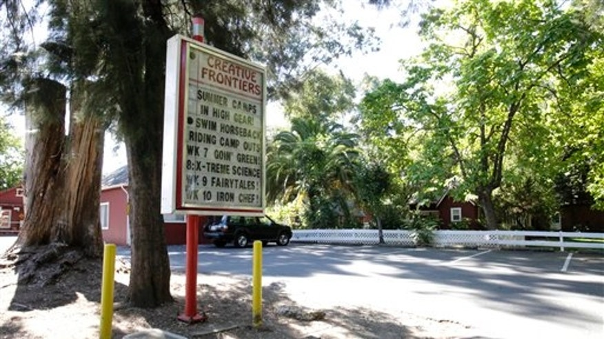 July 19: A welcome sign at the entrance to the Creative Frontiers preschool and elementary school is seen after California officials closed the private school amid accusations of child molestation, in Citrus Heights, Calif.