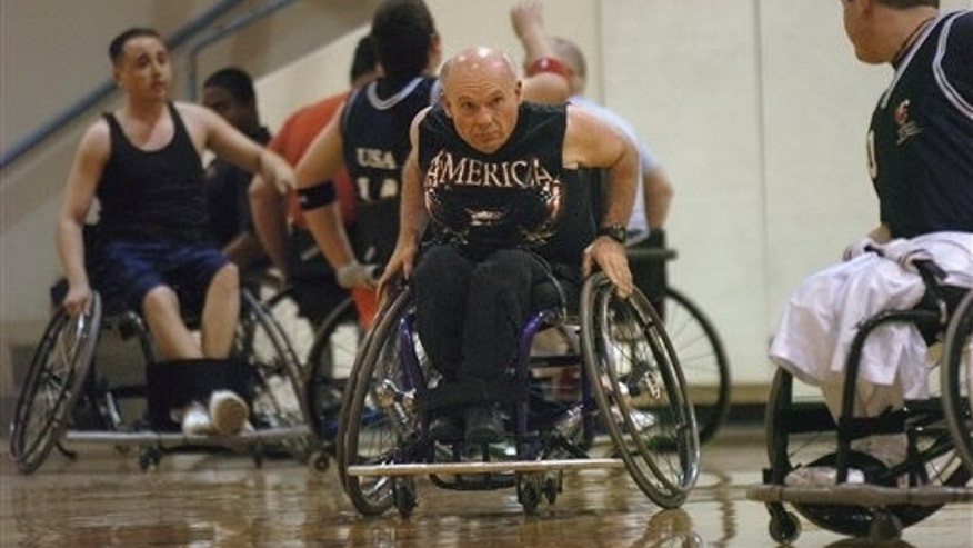 "District Court Judge Albert S. ""Pat"" Murdoch during a game at Johnson Gym, in Albuquerque."