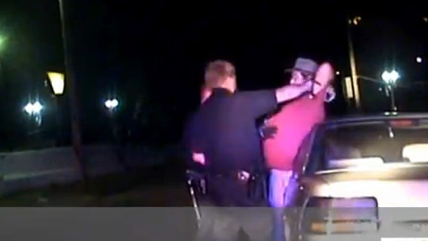 A video obtained by a gun rights group shows a Canton police officer grow irate during an arrest.