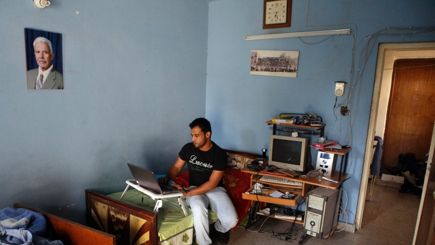 July 26: Hussein Ibrahim al-Tikriti works on a laptop at his home in Baghdad, Iraq. Al-Tikriti, a native of Saddam Hussein's hometown and a translator for American and British security companies, hoped to find safety by moving to the United States under a program designed to help Iraqis whove risked their lives for the U.S. government.