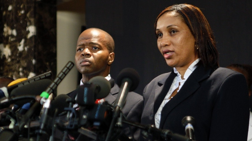 July 28: Nafissatou Diallo, right, who accused former IMF Head Dominique Strauss-Kahn of sexually attacking her, speaks to reporters as her attorney Ken Thompson listens during a news conference at the Christian Cultural Center in the Brooklyn borough of New York.