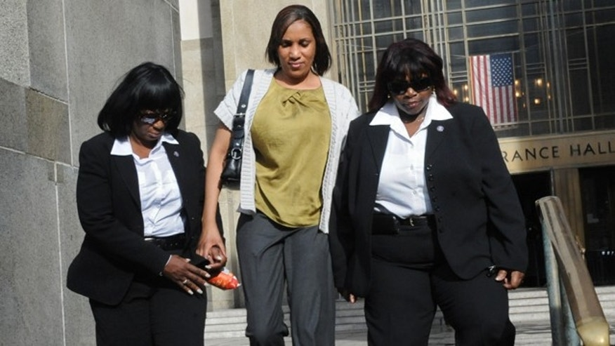 July 27: Nafissatou Diallo, center, leaves Manhattan criminal court in New York.