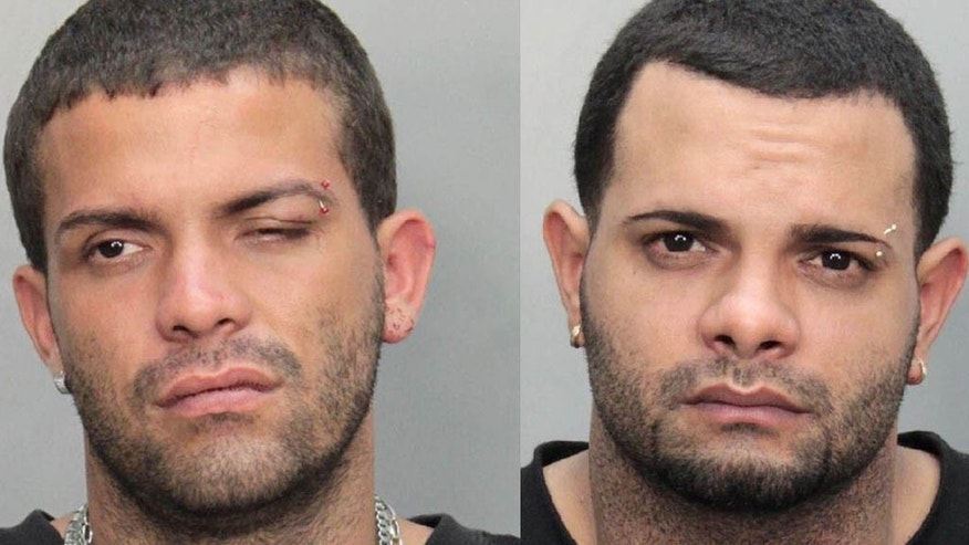 July 27: These booking mugshots, released by Miami-Dade police Department, show Luis and Jonathon Baez of Puerto Rico in Miami. The two brothers were arrested after they punched an American Airlines pilot at the Miami International Airport.