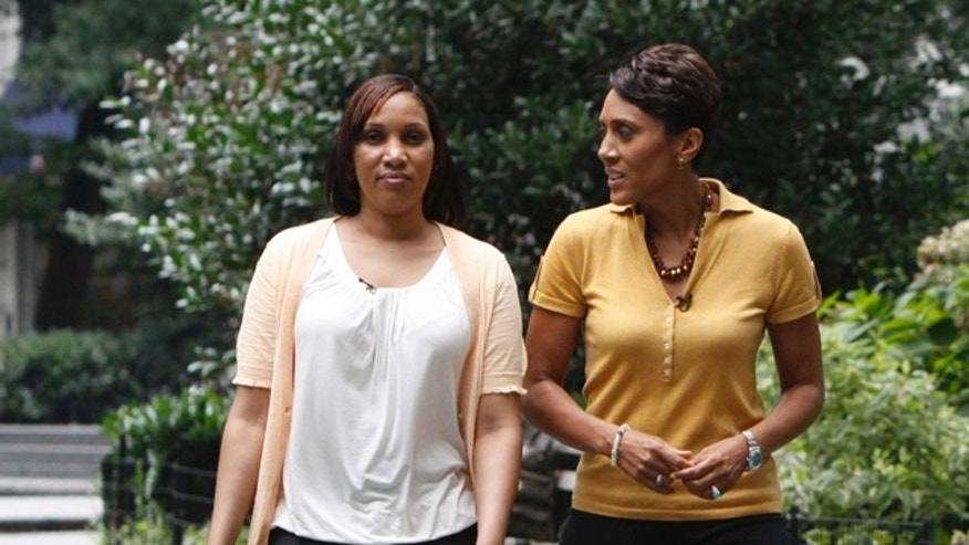 In this undated photo provided by ABC News, Robin Roberts, right, talks to Nafissatou Diallo, the alleged victim in the Dominique Strauss-Kahn assault case.