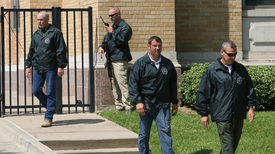July 29, 2011: U.S. Marshals take position at a United States federal courthouse security gate during an appearance by AWOL soldier Pfc. Naser Abdo in Waco, Texas. Abdo is accused of plotting an attack on Fort Hood.