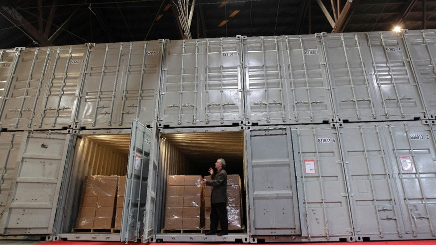 "July 21: Brewster Kahle, digital librarian for the Internet Archive, discusses how books are stored in converted shipping containers at the Internet Archive's Physical Archive warehouse in Richmond, California. The founder of the Internet Archive wants to expand his effort to provide ""universal access to all knowledge"" by preserving a physical copy of every book ever written."