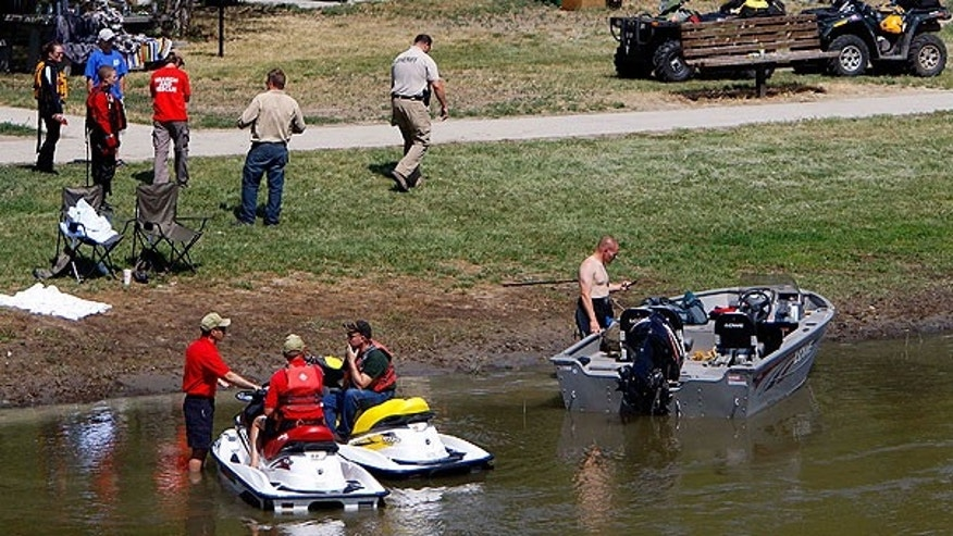 July 29: Rescuers continue to search for Converse County Deputy Bryan Gross, who has been missing since he swam into a swollen eastern Wyoming river to help a struggling girl Thursday evening near Douglas, Wyo.