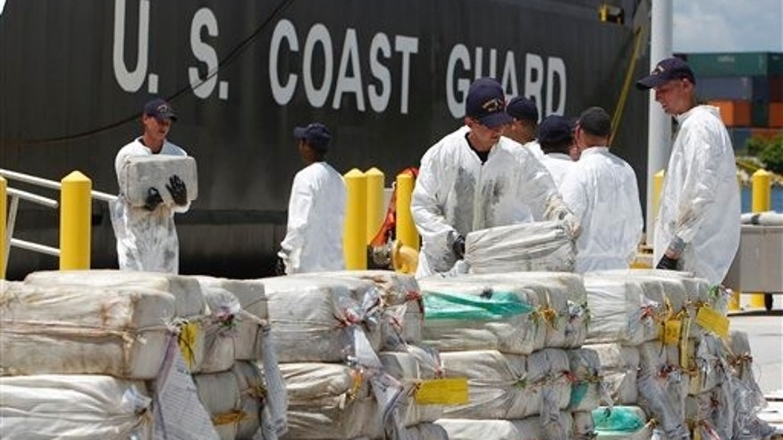 August 2: U.S. Coast Guard crew members unload roughly 7.5 tons of cocaine in Miami Beach, FL.