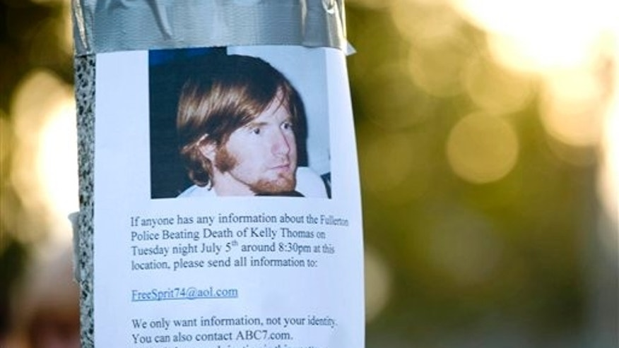 July 12: One of the posters the Thomas family posted around the Fullerton Transportation Center in the hopes of eliciting information and video of a police beating they believe led to the death of Kelly Thomas is shown in Fullerton, CA.