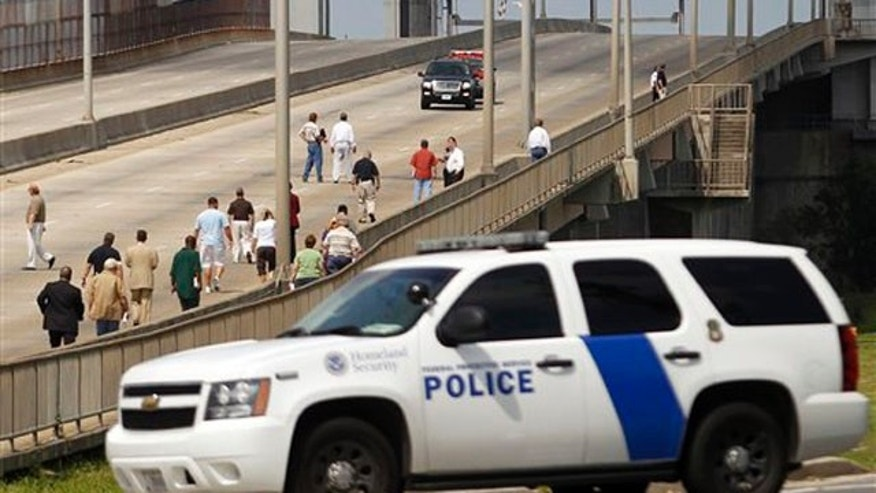 July 26: Jurors walk accross the Danziger Bridge in New Orleans where police shot and killed two people, wounding others, after Hurricane Katrina.
