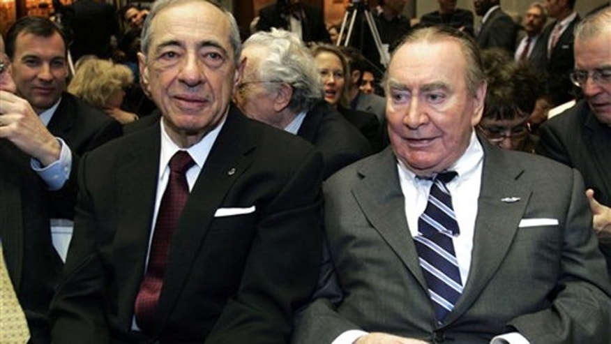 In this Jan. 7, 2009 photo, former New York Govs. Mario Cuomo, left, and Hugh Carey are seen at the Capitol in Albany, N.Y. Carey, who led the rescue effort that brought New York City back from the brink of bankruptcy during its 1975 fiscal crisis, died Sunday, Aug. 7, 2011. He was 92.