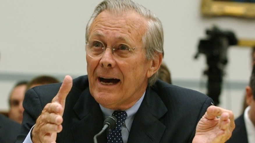 FILE: Former Defense Secretary Donald Rumsfeld testifies on Capitol Hill in Washington.