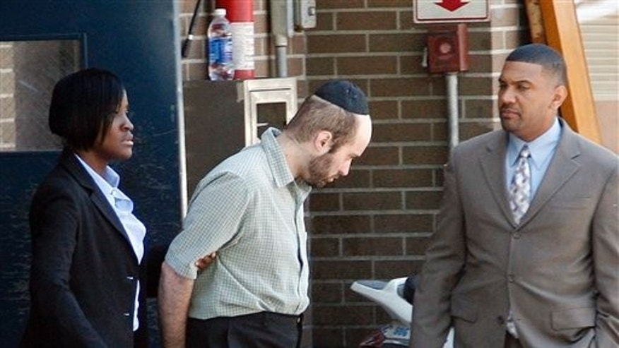 July 14: Detectives walk Levi Aron, center, to a police car at a Brooklyn precinct.