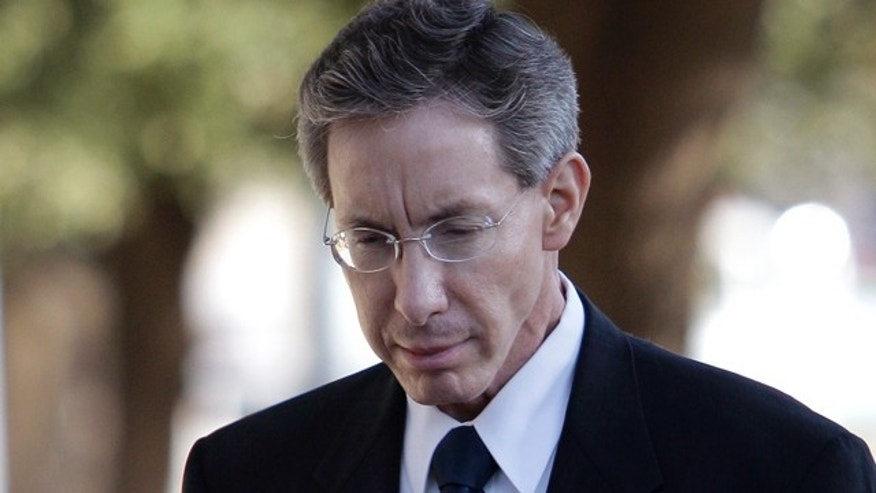 July 28: Polygamist sect leader Warren Jeffs arrives at court in San Angelo, Texas.