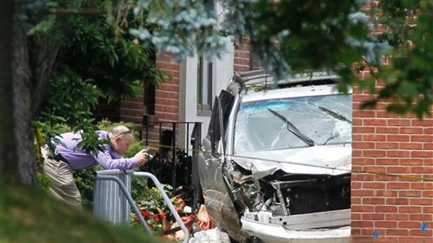 August 10: A law enforcement official photographs a vehicle in front of St. Matthews Roman Catholic Church, where three pedestrians were killed, in Voorheesville, N.Y.