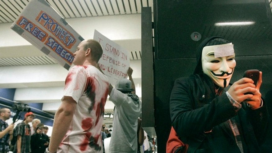 Aug. 15: An unidentified protester uses his cell phone during a protest at the Civic Center BART station in San Francisco.
