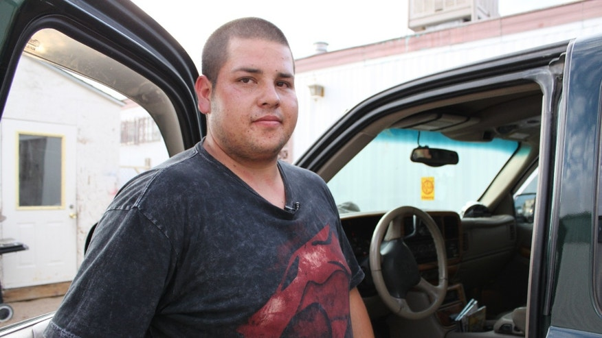 August 16: Antonio Diaz Chacon stands next to his truck in front of his home in Albuquerque, N.M. while talking to reporters about his efforts to save a 6-year-old girl who was abducted.