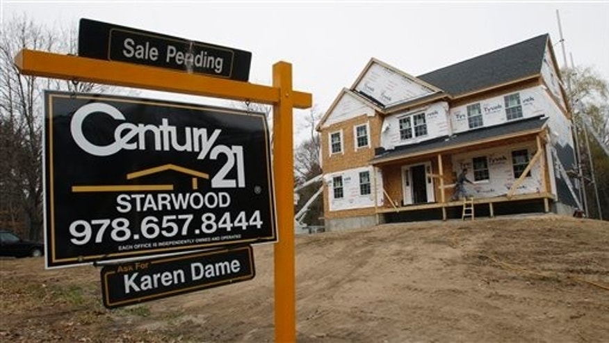 April 12: A sale pending sign is posted on the realty sign, at a home in Wilmington, Mass.