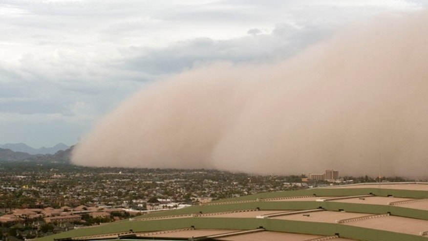 Aug. 18: A dust storm moves to consume Camelback Mountain in Phoenix, Ariz.