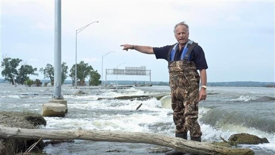 August 18: Rep. Steve King, R-Iowa stands in flood water from the Missouri River at the junction of Interstate 680 and Interstate 29, near Crescent, Iowa.