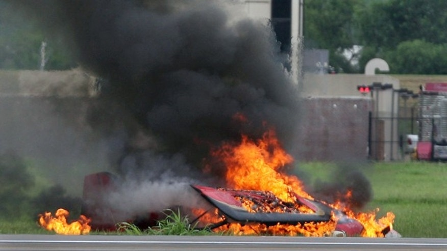 Aug. 20: Remains of a fiery crash that killed a stunt pilot who couldnt pull out of a downward spiral are seen during the Kansas City Air Expo Air Show at the Kansas City Wheeler Downtown Airport.
