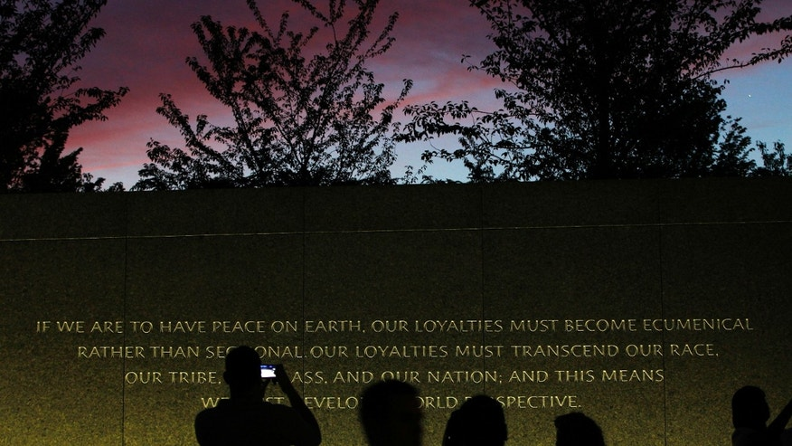 August 22: A quote is inscribed into the wall at the Martin Luther King, Jr. Memorial as it is seen at dusk ahead of its dedication this weekend in Washington.