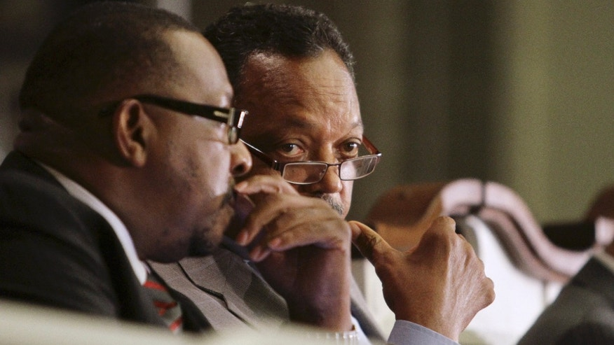 August 22: Bishop Victor T. Curry, left, and Rev. Jesse Jackson talk during a town hall meeting in Miami. The Congressional Black Caucus organized the meeting to address black unemployment rates, one of five taking place in August in distressed communities across the country. At issue is the stubbornly high unemployment rate in the black community, now at 16.8 percent nationwide, more than double that for whites.