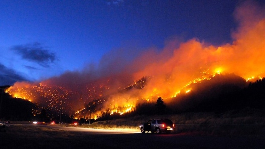 Aug. 22: Flames light up the evening sky near Missoula, Mont., as a wildfire burns through timber.