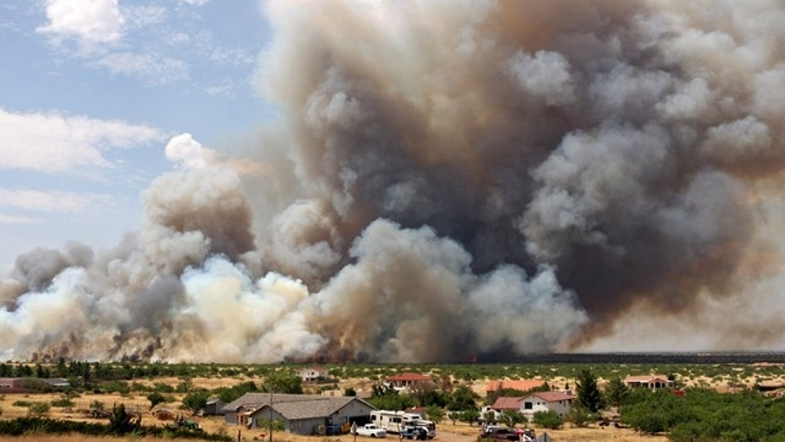 June 17: Large plumes of smoke rise from a fire that started on Fort Huachuca behind a nearby neighborhood in Sierra Vista, Ariz.