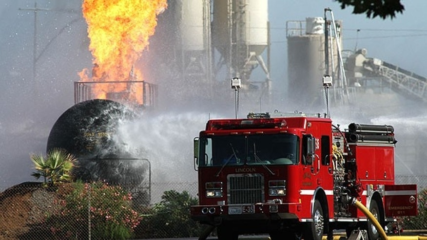 Aug. 24: Firefighters pour water on a burning a rail car loaded with 29,000 gallons of liquid propane in Lincoln, Calif.