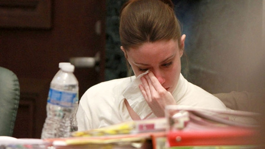June 9: Casey Anthony reacts to evidence photos showing the skeletal remains of her daughter Caylee Anthony shown during her trial at the Orange County Courthouse in Orlando, Fla. Anthony, 25, is charged with killing her daughter Caylee in the summer of 2008.