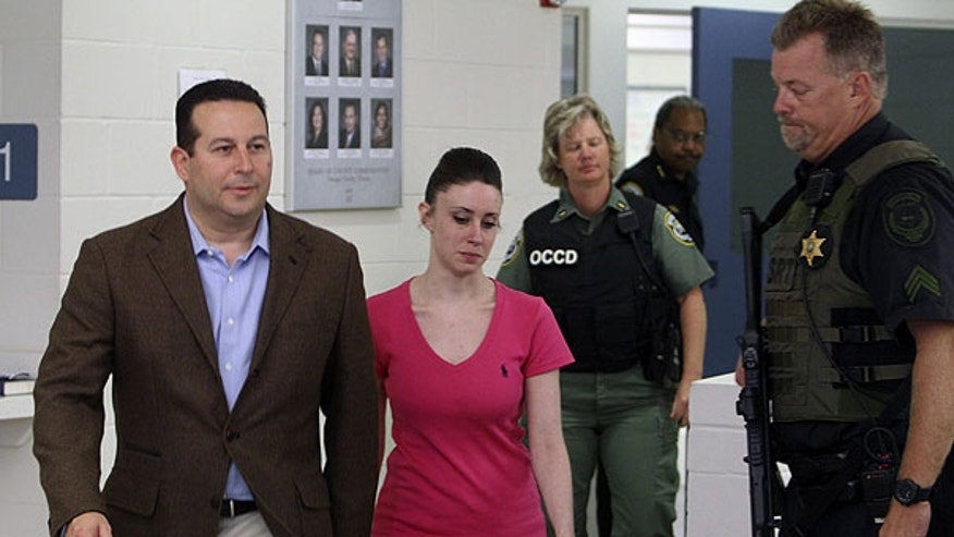 July 17: Casey Anthony, center, walks out of the Orange County Jail with her attorney Jose Baez, left, during her release in Orlando, Fla., early Sunday.
