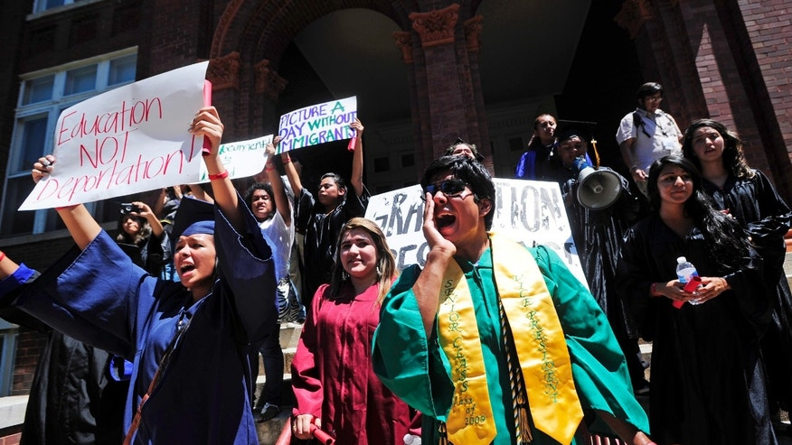 August 23: Gustavo Madrigal, right, shouts outside the admissions office during a protest at the University of Georgia in Athens, Ga. The group gathered to protest a new university system policy on the admission of illegal immigrants, the latest in a string of demonstrations staged in recent months in Georgia by illegal immigrant young people and their supporters.
