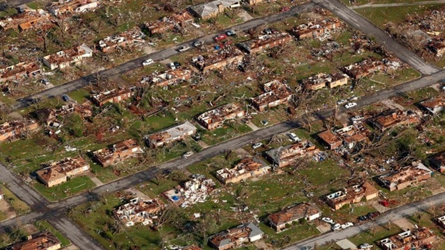 May 24: Aerial file photo shows a neighborhood destroyed by a powerful tornado in Joplin, Mo.