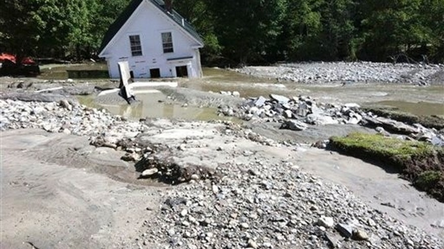 Aug. 29: This photo provided by Marc Leibowitz shows a partially submerged home in Pittsfield, Vt., after Tropical Storm Irene passed through on Sunday.