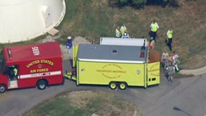 August 31: Emergency personnel are seen at Scott Air Force Base in Mascoutah, Illinois, where three people were hospitalized with rashes after a suspicious package arrived at the base's mail center. The package prompted precautionary evacuations of the base's education center, bowling alley and other services near the mail center.