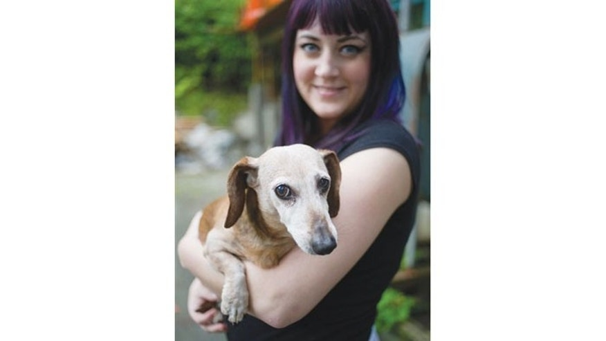 August 30: Brook Collins holds her dog, Fudge, at her home in Juneau, Alaska.