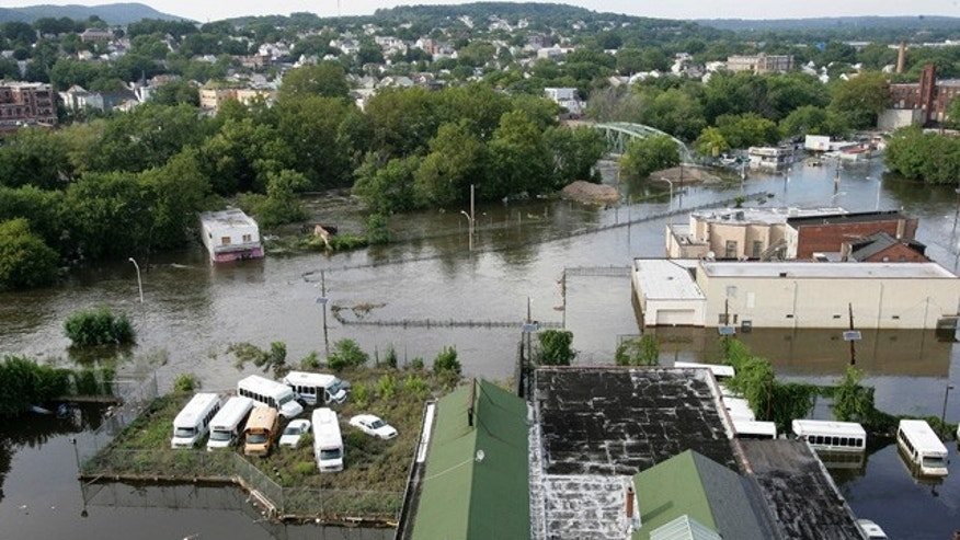 Aug. 31: The swollen Passaic River floods River Road in Paterson, N.J.