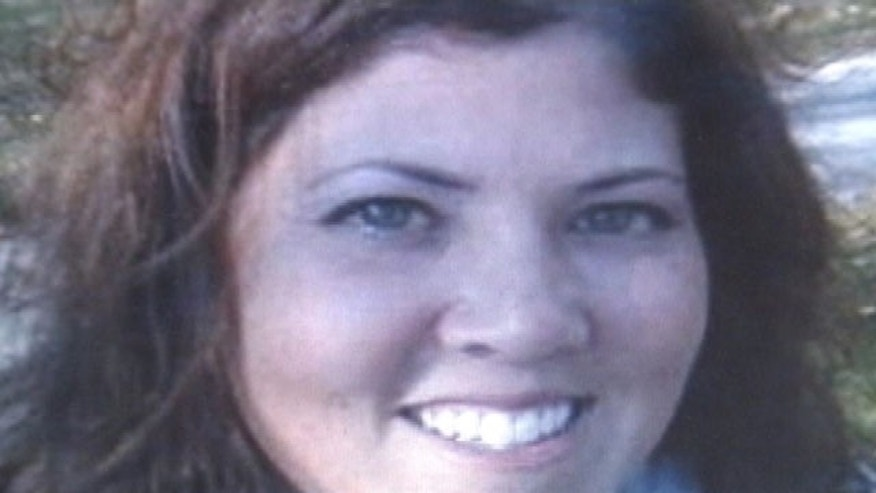 Jennifer Webb, whose body was found early Wednesday in rural Michigan, is shown in this photo she posted on social networking sites and was included in her obituary.