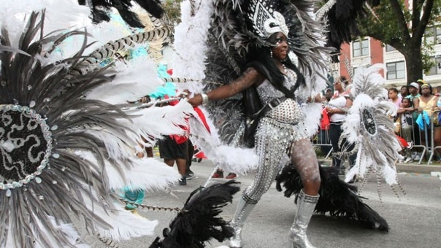 Sept. 5: Dressed in costume, Faith Fletcher makes her way along Eastern Parkway in the Brooklyn borough of New York as she takes part in the West Indian Day Parade.