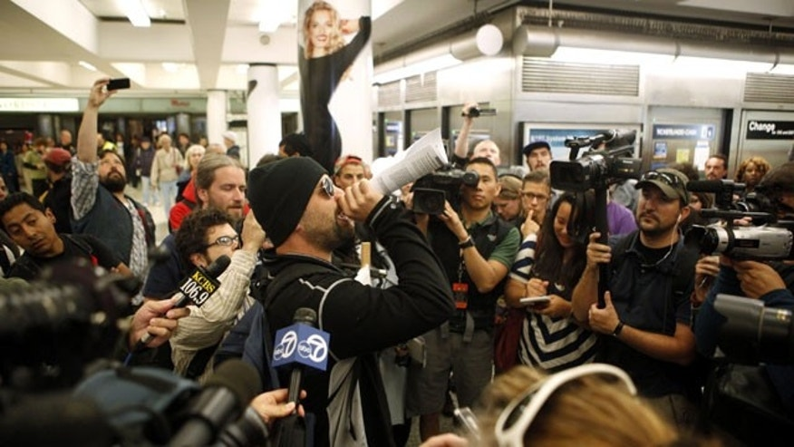 September 8: The leader of the protest issues instructions to other protesters in the Powell Street BART and MUNI station in San Francisco.