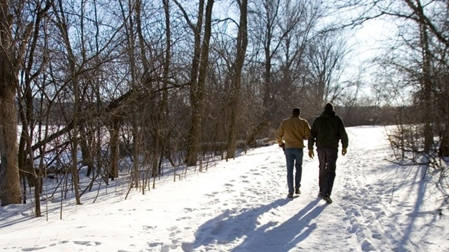 Brothers Rink, left, and Jim DaVee walk on a snow-covered trail Wednesday, March, 7, 2007, in Madison, Wis. Prevention magazine has named Madison as the most walkable of the country's 100 most populated cities. (AP Photo/Andy Manis)
