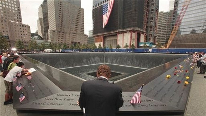 Sept. 11: Michael Lehrman, Executive Managing Director of Cantor Fitzgerld and Co., bows his head at the names of some of the over 600 employees from Cantor Fitzgerald who lost their lives in the 2001 terrorist attacks.