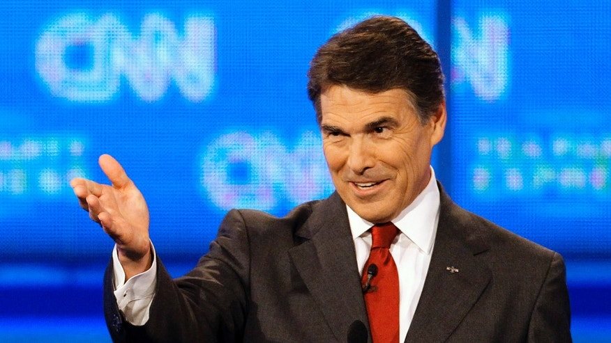 September 12: Republican presidential candidate Texas Gov. Rick Perry gestures during a Republican presidential debate in Tampa, Florida.