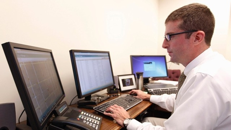 Sept. 13: Brett Goldstein, Chicago's chief data officer, works at a bank of computers in his office. On Wednesday, Sept. 14, Chicago will post online millions of crime statistics dating back to 2001. Experts say the department will be a national leader in making that information available online.