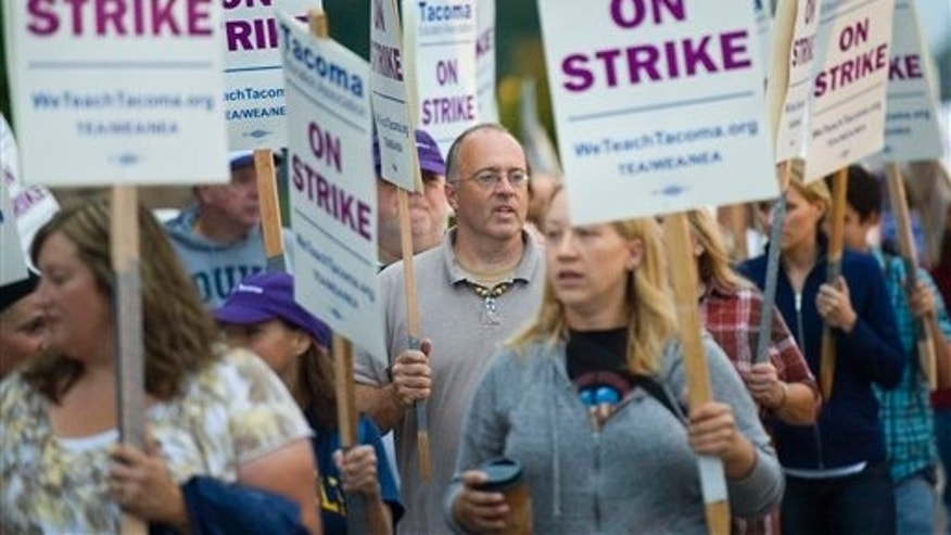 Sept. 13: Monte Gibbs, a teacher and coach in the Tacoma School District, center, walks a picket line in front of Lincoln High School with more than 100 other teachers, in Tacoma, Wash. Eighty-seven percent of the Tacoma Education Association's total membership voted Monday evening to walk out, after weekend contract negotiations failed to result in an agreement, union spokesman Rich Wood said.