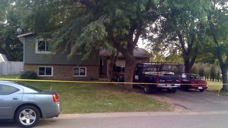 Police rope off house where three bodies were found in Oakdale, Minn.
